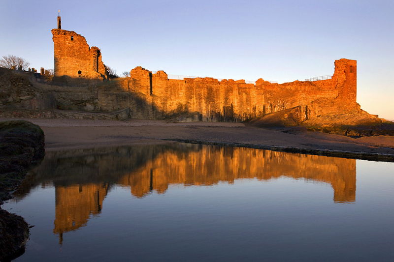 St Andrews Castle reflected in the Bathing Pond at Sunrise Fife